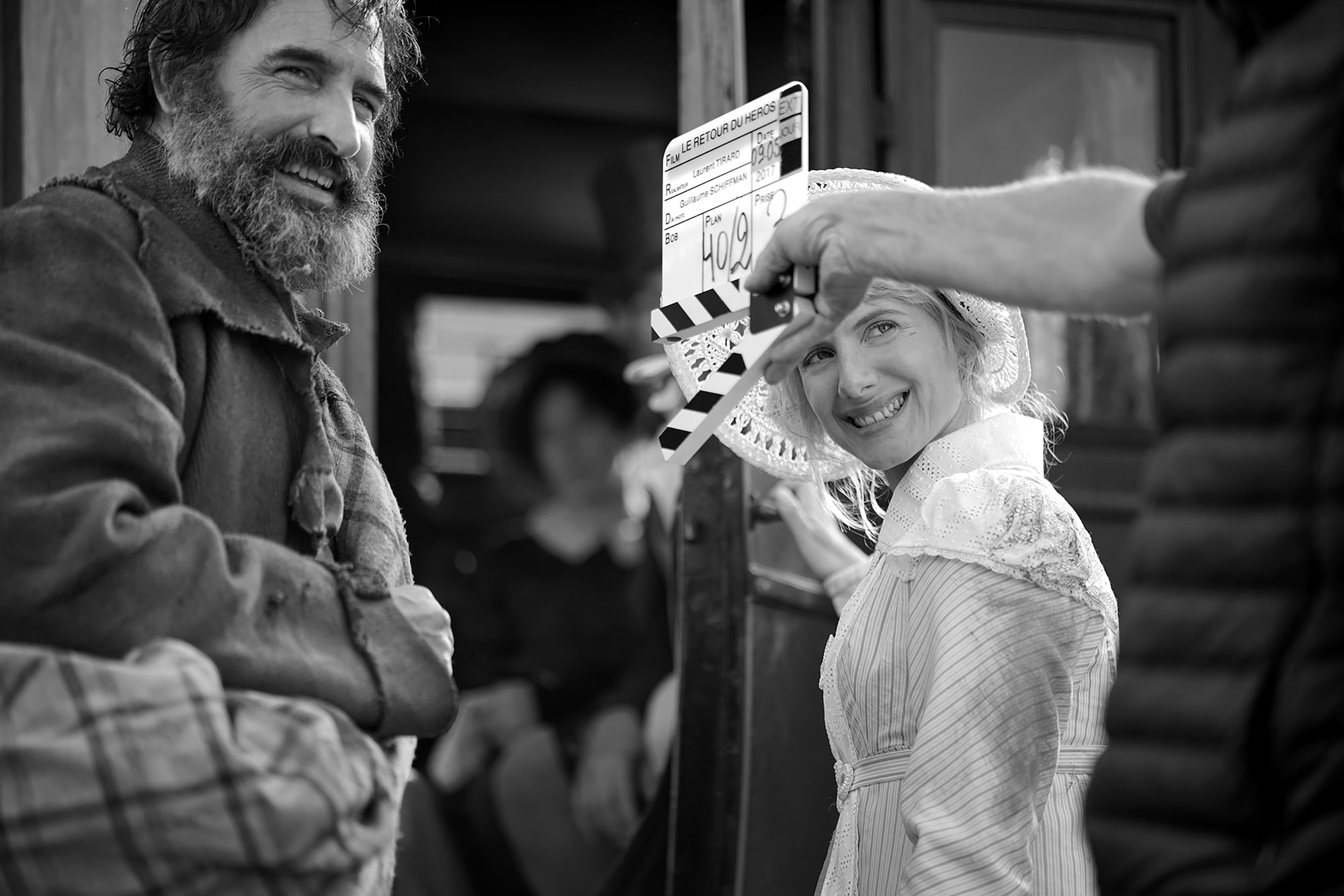 Christophe Brachet Sony Alpha 7RII jean dujardin and melanie laurent laughing as a clapperboard operator prepares for a take